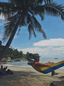 Fifi guļamtīkls pastkartišu pludmalē